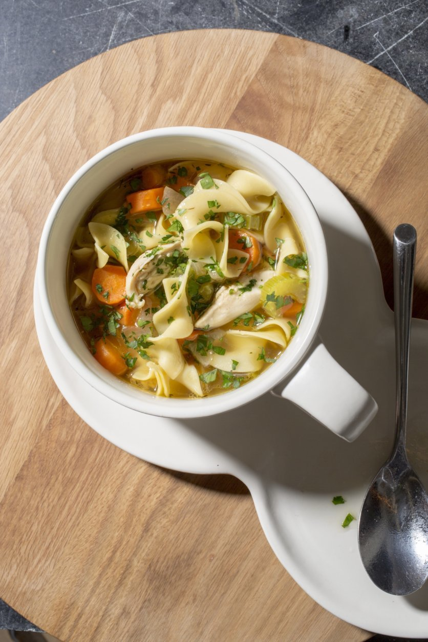 This undated photo provided by America's Test Kitchen in November 2018 shows classic chicken noodle soup.  (Carl Tremblay/America's Test Kitchen via AP)