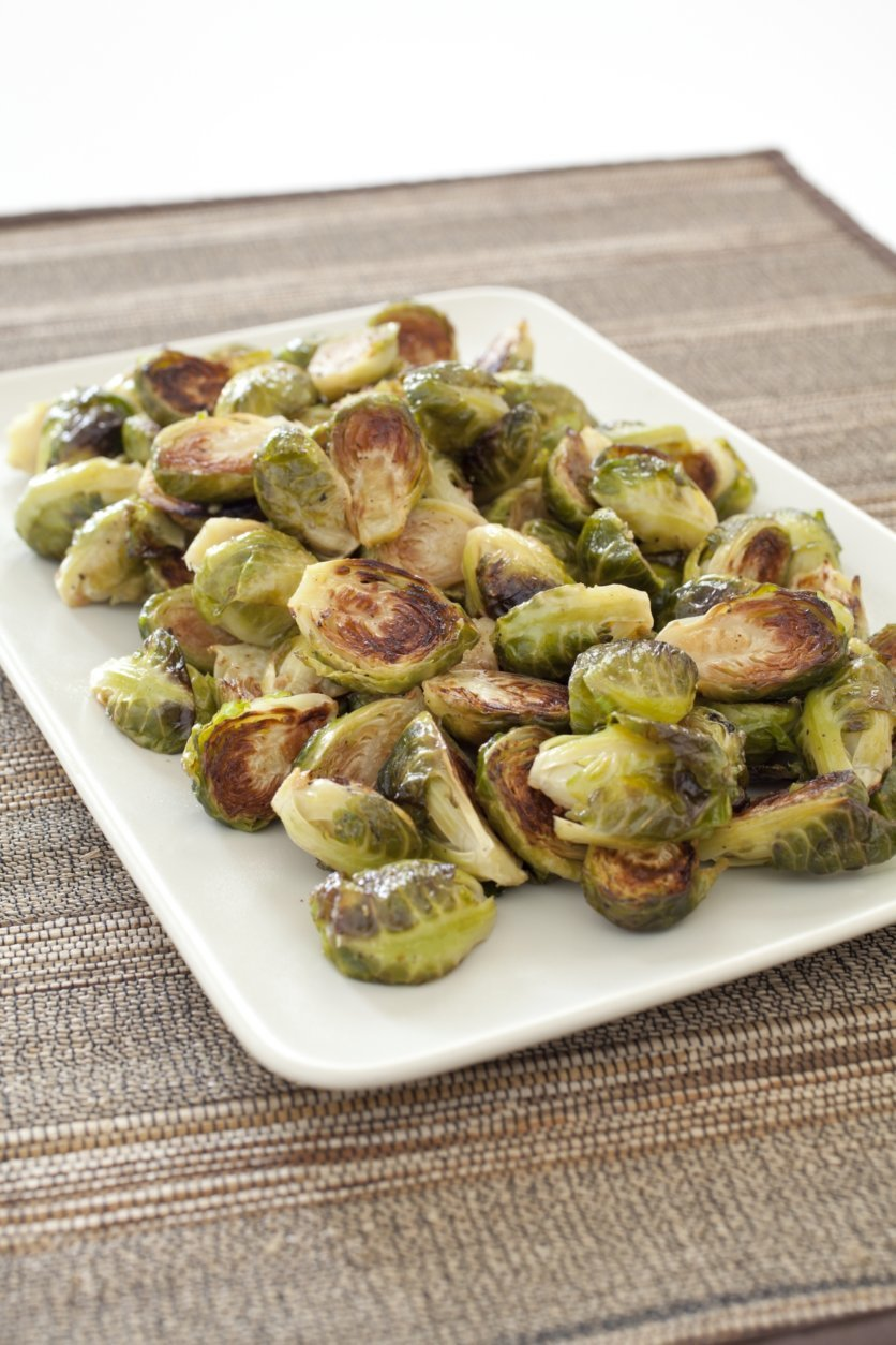 """This undated photo provided by America's Test Kitchen in November 2018 shows roasted Brussels sprouts in Brookline, Mass. This recipe appears in the cookbook """"Complete Make-Ahead."""" (Carl Tremblay/America's Test Kitchen via AP)"""