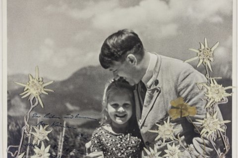 Photo of Hitler embracing child of Jewish grandmother sold