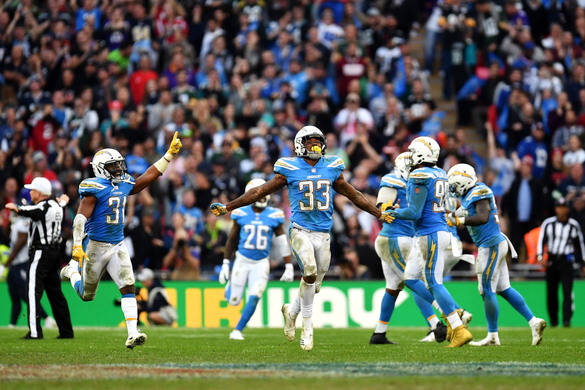 LONDON, ENGLAND - OCTOBER 21: Derwin James (33) of the Los Angeles Chargers celebrates with team mates after the final turnover during the Tennessee Titans against the Los Angeles Chargers at Wembley Stadium on October 21, 2018 in London, England. (Photo by Justin Setterfield/Getty Images)