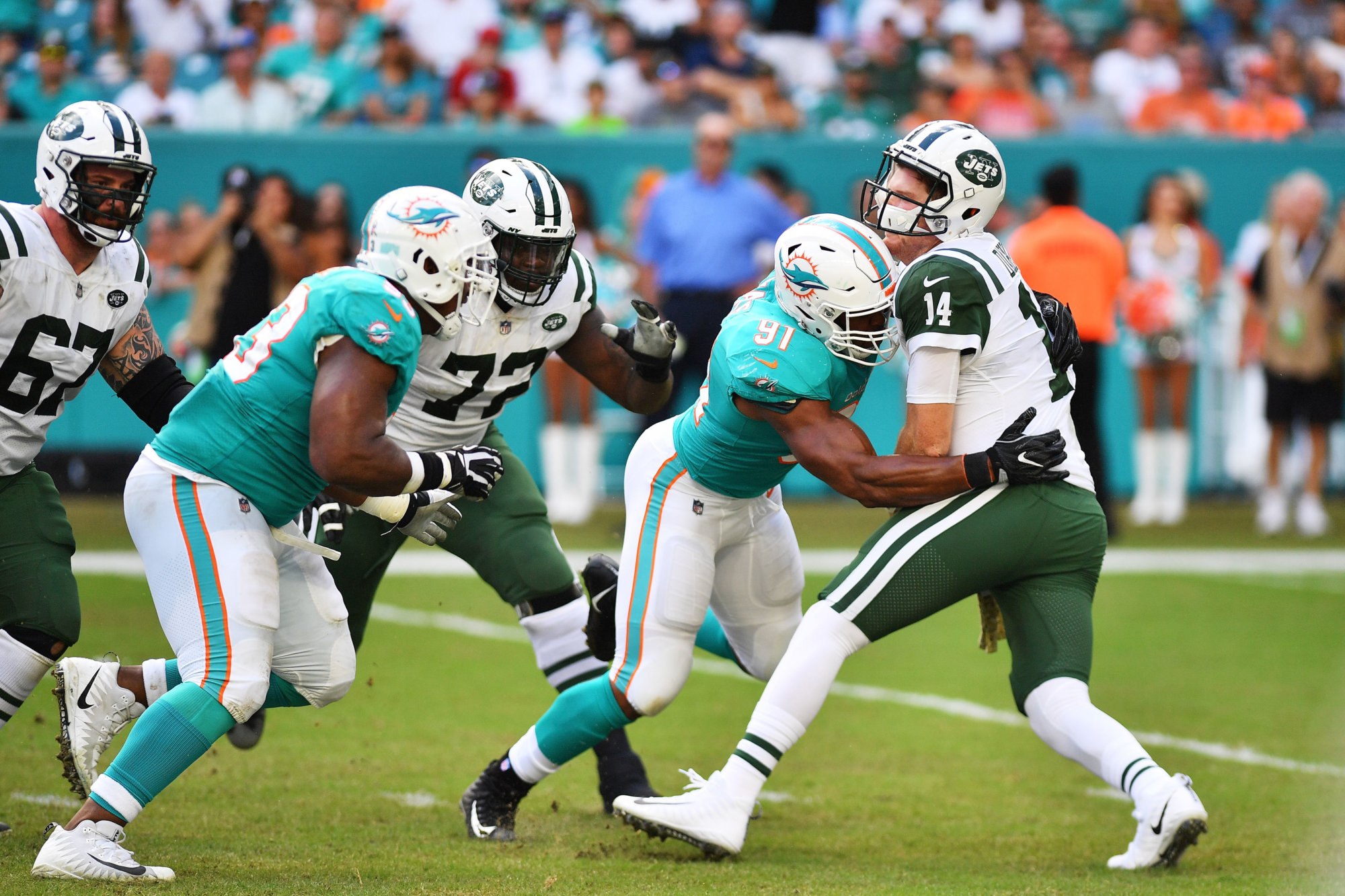 MIAMI, FL - NOVEMBER 04:  Cameron Wake #91 of the Miami Dolphins sacks Sam Darnold #14 of the New York Jets in the second quarter of their game at Hard Rock Stadium on November 4, 2018 in Miami, Florida.  (Photo by Mark Brown/Getty Images)