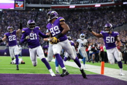 MINNEAPOLIS, MN - NOVEMBER 4: Danielle Hunter #99 of the Minnesota Vikings scores a touchdown after recovering a fumble in the fourth quarter of the game against the Detroit Lions at U.S. Bank Stadium on November 4, 2018 in Minneapolis, Minnesota. (Photo by Adam Bettcher/Getty Images)