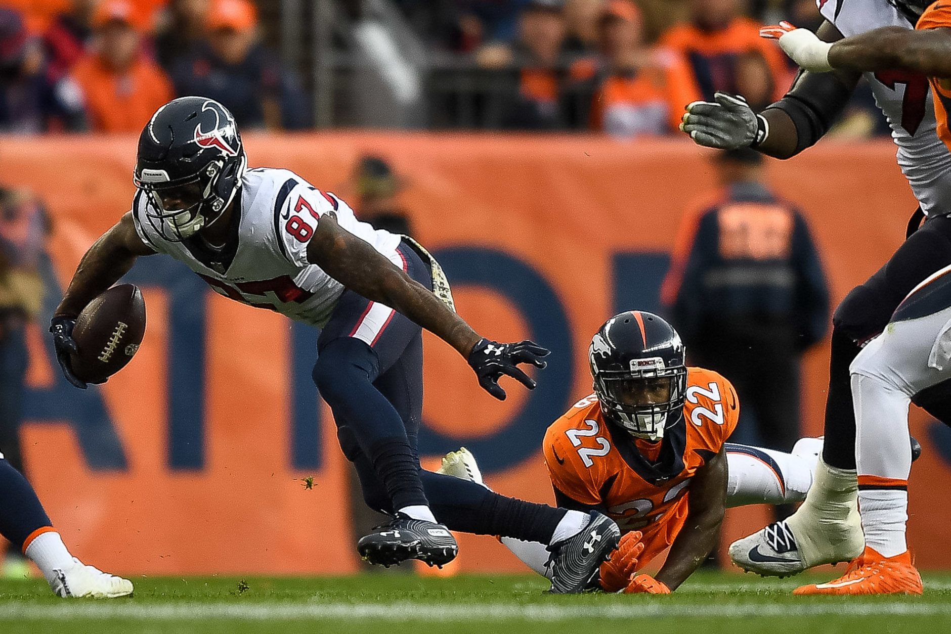 DENVER, CO - NOVEMBER 4:  Wide receiver Demaryius Thomas #87 of the Houston Texans breaks away from a tackle attempt by defensive back Tramaine Brock #22 of the Denver Broncos in the first quarter of a game at Broncos Stadium at Mile High on November 4, 2018 in Denver, Colorado. (Photo by Dustin Bradford/Getty Images)