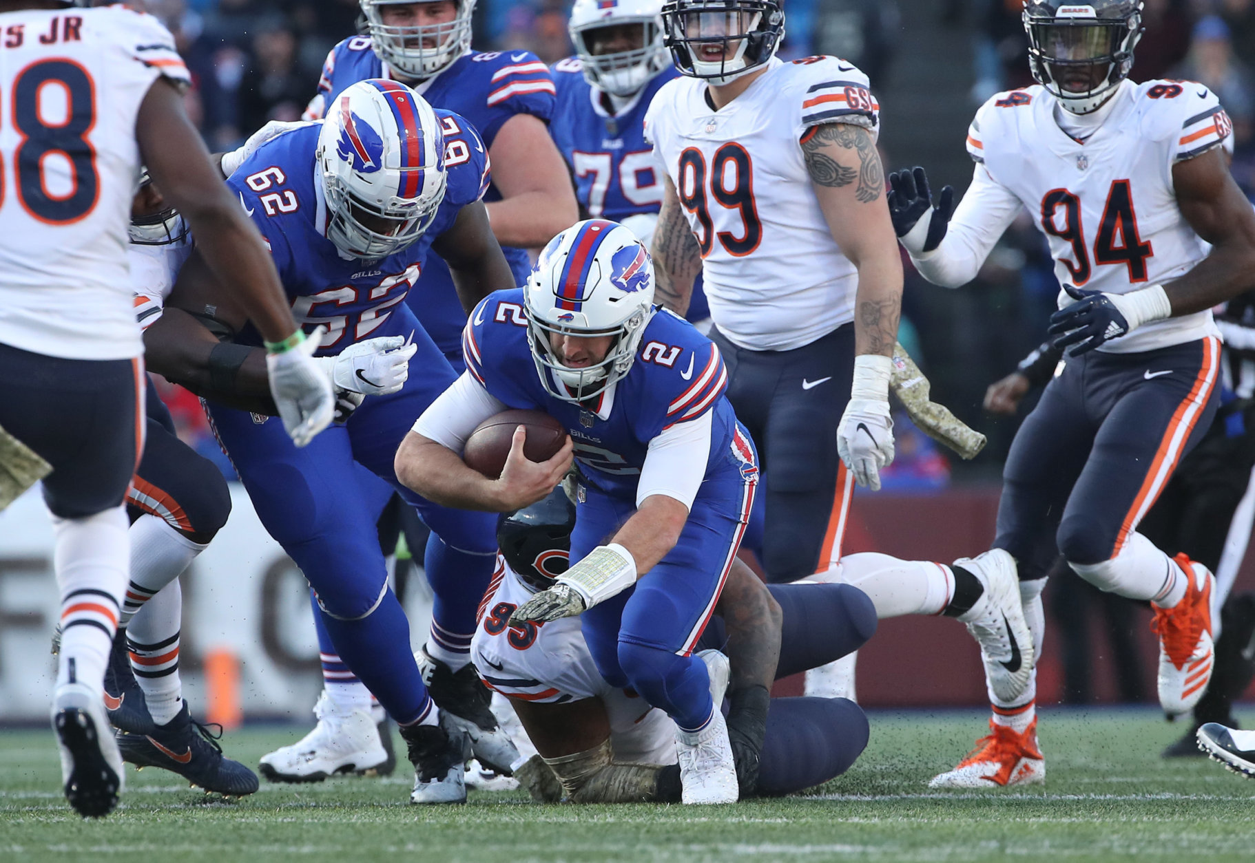 BUFFALO, NY - NOVEMBER 04: Nathan Peterman #2 of the Buffalo Bills is tackled as he runs with the ball by Roy Robertson-Harris #95 of the Chicago Bears in the third quarter during NFL game action at New Era Field on November 4, 2018 in Buffalo, New York. (Photo by Tom Szczerbowski/Getty Images)