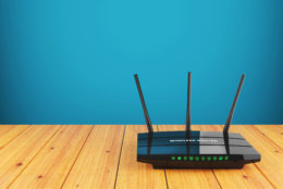 Wi-Fi wireless router on wooden table 3d
