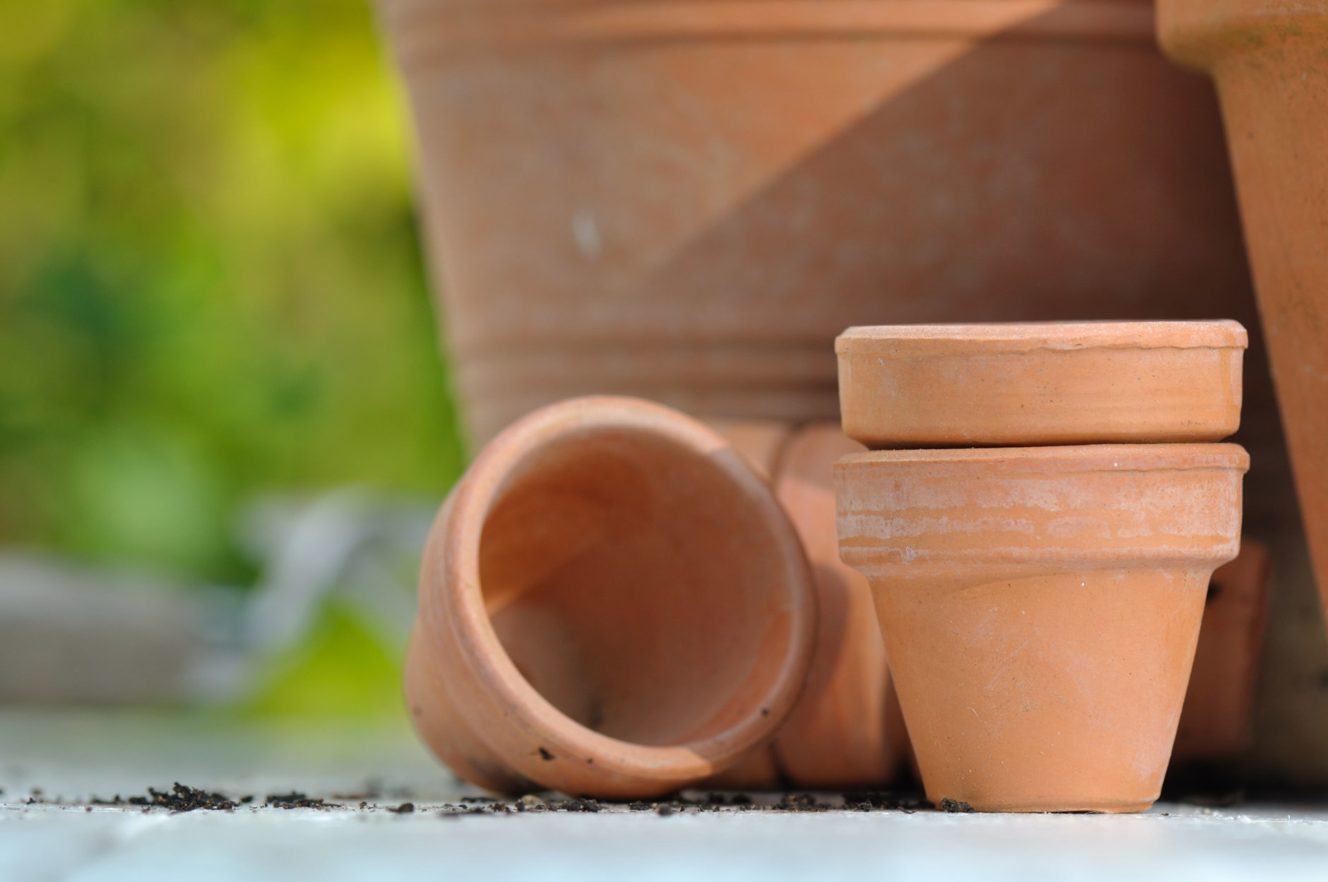 different sizes of terracotta pots on outdoor table