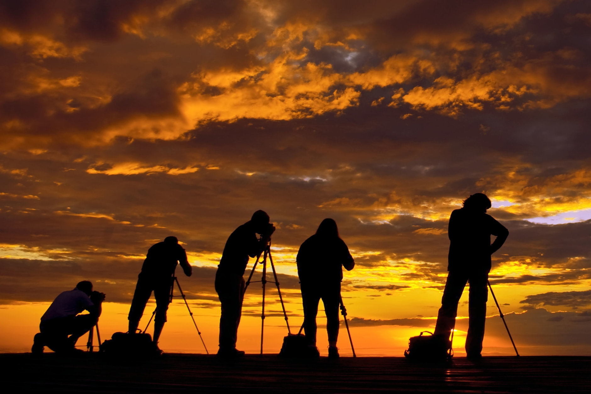 photographers in backlight at sunrise