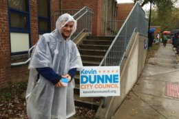 Kevin Dunne, candidate for Alexandria City Council, greets voters in the rain at the MacArthur Precinct in Alexandria, Virginia, on Nov. 6, 2018. (Courtesy Linda App)