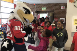 """When meeting mascot Slapshot, an astounded child asked, """"There's a person in there?"""" (WTOP/Kristi King)"""