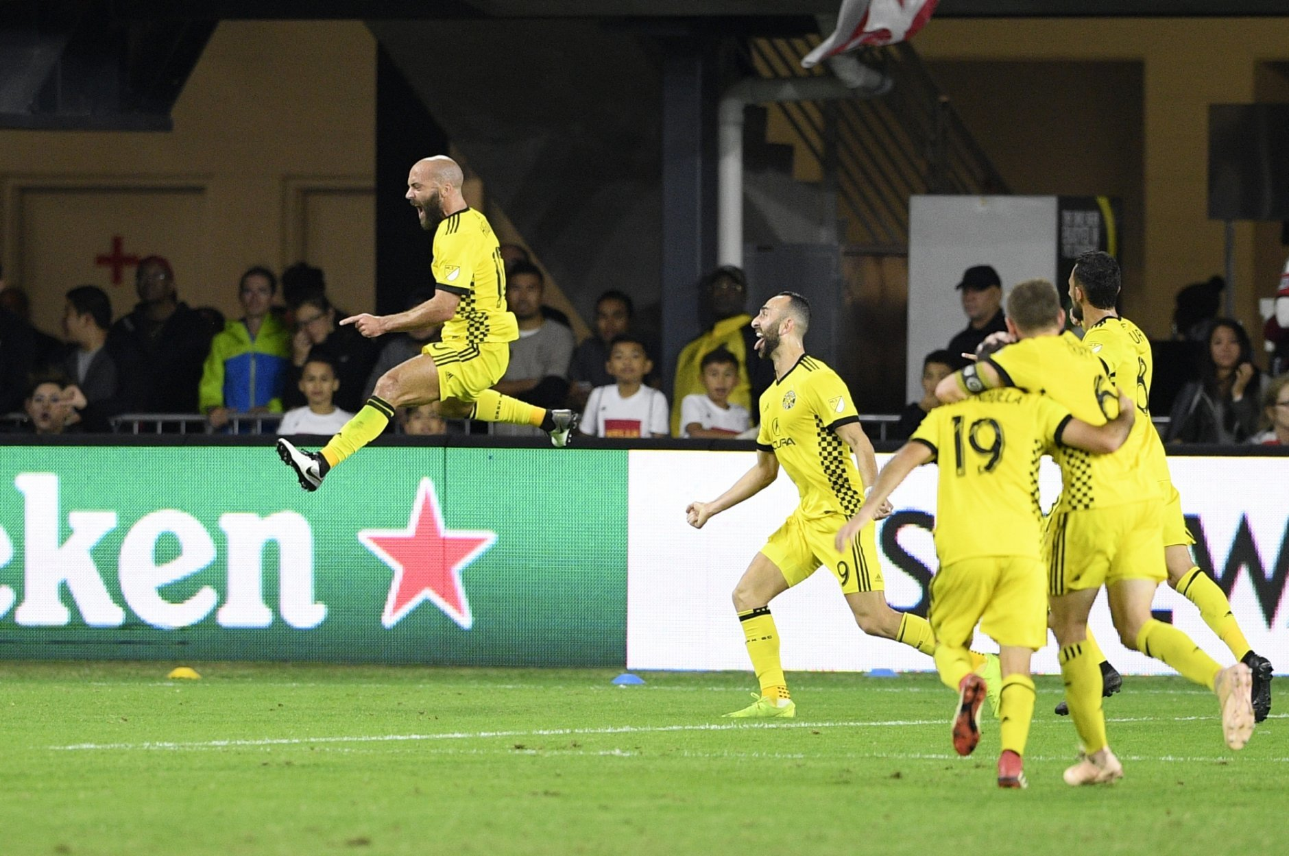 Columbus Crew SC forward Federico Higuain, left, celebrates his goal with midfielder Justin Meram (9) and others during the first half of an MLS playoff soccer match against D.C. United, Thursday, Nov. 1, 2018, in Washington. (AP Photo/Nick Wass)