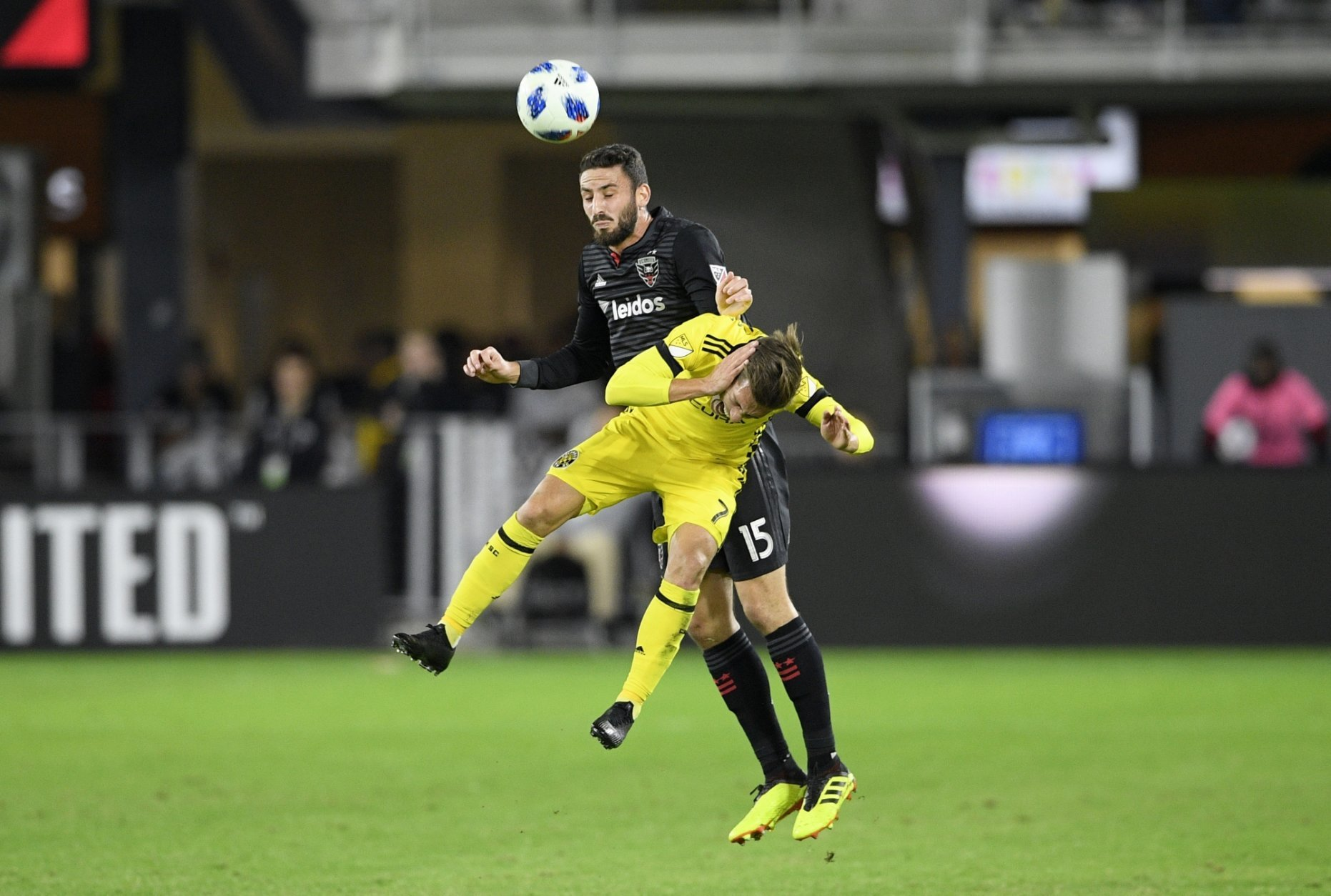 D.C. United defender Steve Birnbaum (15) batted for the ball against Columbus Crew SC midfielder Pedro Santos (7) during the first half of an MLS playoff soccer match, Thursday, Nov. 1, 2018, in Washington. (AP Photo/Nick Wass)
