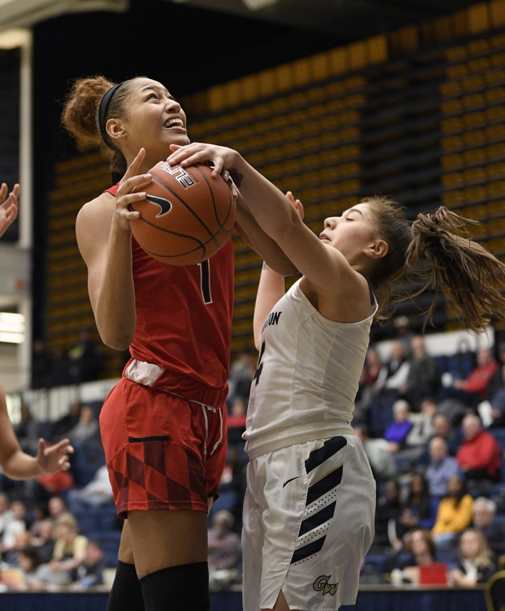 George Washington guard Lexus Levy, right, reaches in for the ball against Maryland forward Shakira Austin (1) during the second half of an NCAA college basketball game, Wednesday, Nov. 14, 2018, in Washington. Maryland won 69-30. (AP Photo/Nick Wass)