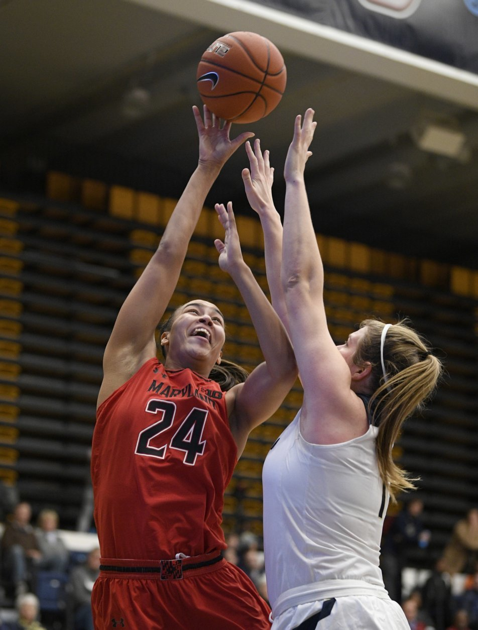 Maryland forward Stephanie Jones (24) goes to the basket against George Washington forward Kelsi Mahoney (1) during the first half of an NCAA college basketball game, Wednesday, Nov. 14, 2018, in Washington. (AP Photo/Nick Wass)