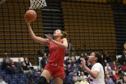 Maryland forward Shakira Austin (1) goes to the basket past George Washington center Kayla Mokwuah, right, during the first half of an NCAA college basketball game, Wednesday, Nov. 14, 2018, in Washington. (AP Photo/Nick Wass)