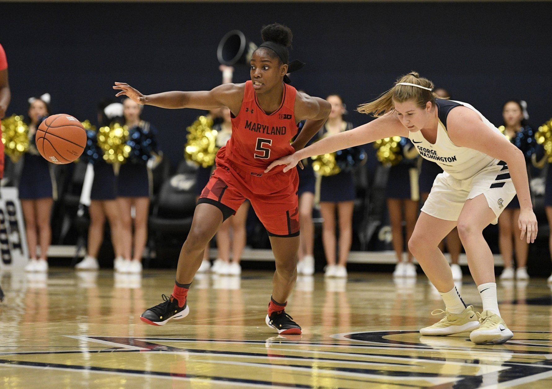 Maryland guard Kaila Charles (5) chases the loose ball against George Washington forward Kelsi Mahoney, right, during the first half of an NCAA college basketball game, Wednesday, Nov. 14, 2018, in Washington. (AP Photo/Nick Wass)