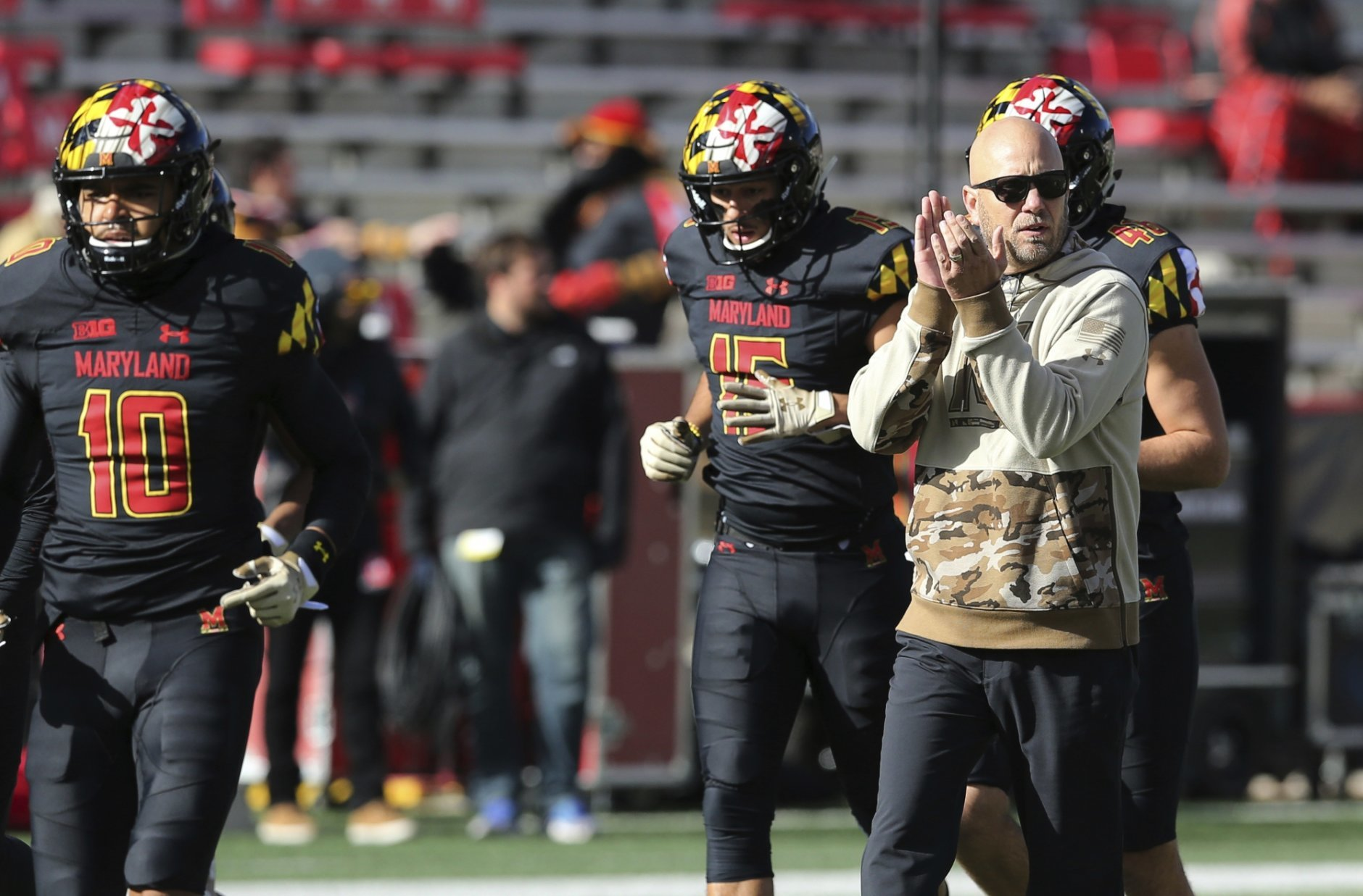 Maryland interim head coach Matt Canada, watches his team warm up before playing Michigan State in an NCAA college football game, Saturday, Nov. 3, 2018, in College Park, Md. (AP Photo/Gary Cameron)