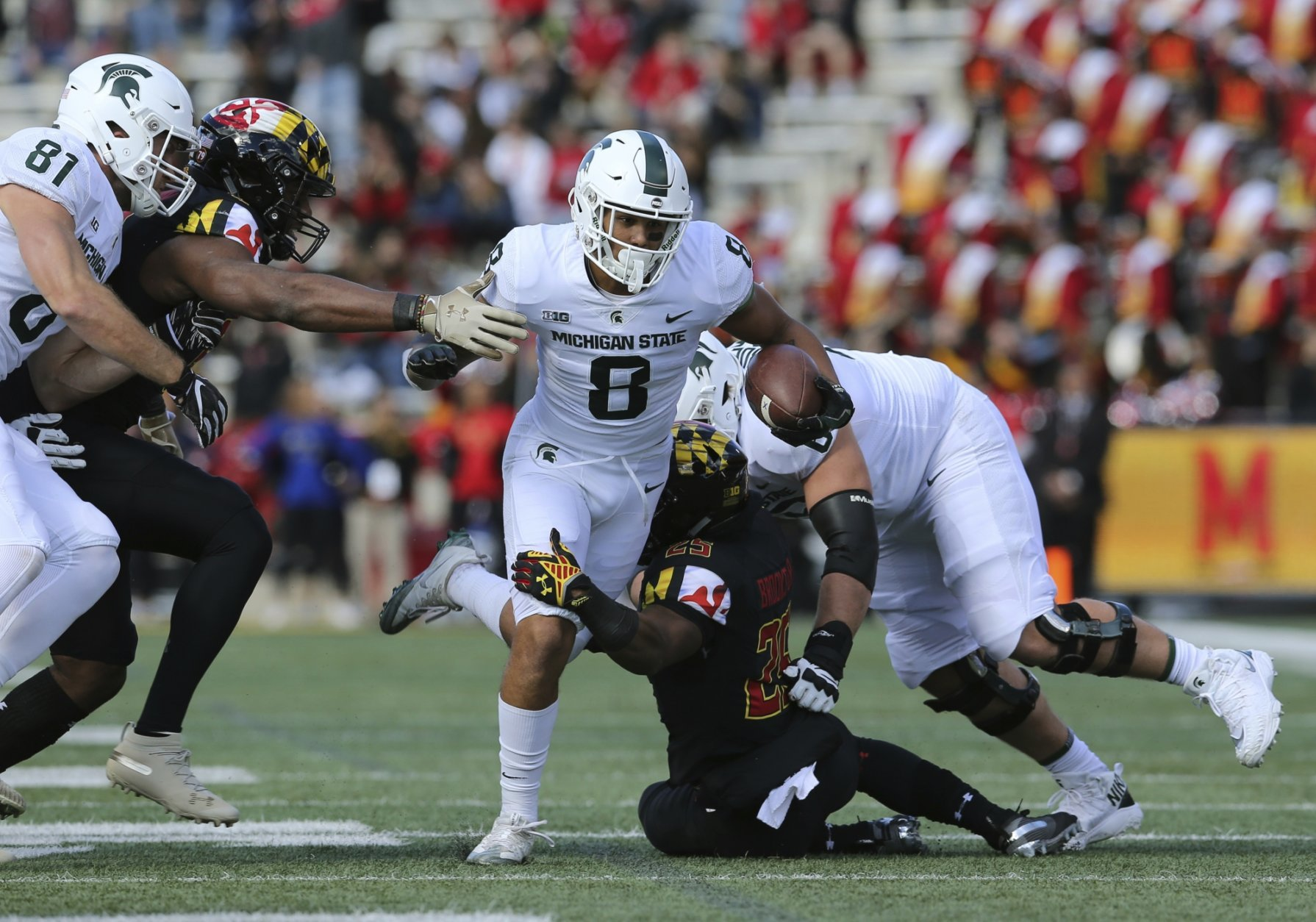 Michigan State receiver Jalen Nailor (8) runs for yardage against Maryland in the first half of an NCAA college football game, Saturday, Nov. 3, 2018, in College Park, Md. (AP Photo/Gary Cameron)