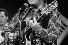 """FILE - In this April 8, 1974, file photo, Roy Clark, one of the leading performers of country music on television, performs in Burbank, Calif. Clark, the guitar virtuoso and singer who headlined the cornpone TV show """"Hee Haw"""" for nearly a quarter century, died Thursday, Nov. 15, 2018, due to complications from pneumonia at home in Tulsa, Okla., publicist Jeremy Westby said. He was 85.   (AP Photo/Harold Filan, File)"""