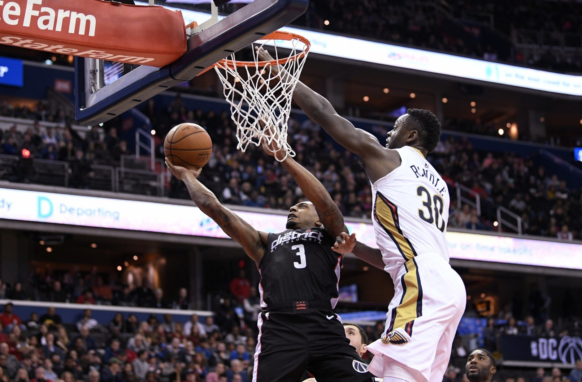 Washington Wizards guard Bradley Beal (3) goes to the basket against New Orleans Pelicans forward Julius Randle (30) during the second half of an NBA basketball game Saturday, Nov. 24, 2018, in Washington. The Wizards won 124-114. (AP Photo/Nick Wass)