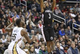 Washington Wizards guard Bradley Beal (3) shoots over New Orleans Pelicans guard E'Twaun Moore (55) during the second half of an NBA basketball game Saturday, Nov. 24, 2018, in Washington. The Wizards won 124-114. (AP Photo/Nick Wass)