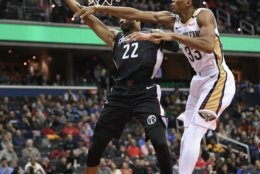 Washington Wizards forward Otto Porter Jr. (22) is fouled by New Orleans Pelicans forward Wesley Johnson (33) during the second half of an NBA basketball game Saturday, Nov. 24, 2018, in Washington. The Wizards won 124-114. (AP Photo/Nick Wass)