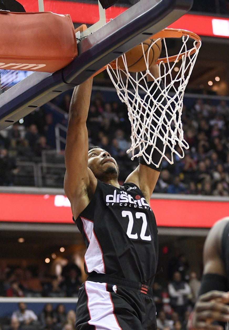 Washington Wizards forward Otto Porter Jr. (22) dunks during the second half of the team's NBA basketball game against the New Orleans Pelicans, Saturday, Nov. 24, 2018, in Washington. The Wizards won 124-114. (AP Photo/Nick Wass)