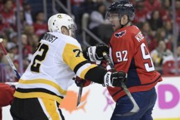 Washington Capitals center Evgeny Kuznetsov (92), of Russia, scuffles with Pittsburgh Penguins right wing Patric Hornqvist (72), Sweden, during the second period of an NHL hockey game, Wednesday, Nov. 7, 2018, in Washington. (AP Photo/Nick Wass)