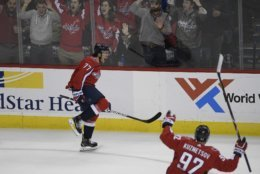 Washington Capitals right wing T.J. Oshie (77) celebrates his goal alongside center Evgeny Kuznetsov (92), of Russia, during the third period of an NHL hockey game against the Pittsburgh Penguins, Wednesday, Nov. 7, 2018, in Washington. The Capitals won 2-1. (AP Photo/Nick Wass)