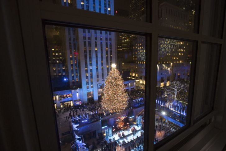 The Rockefeller Center Christmas tree is lit during the 86th annual Rockefeller Center Christmas tree lighting ceremony, Wednesday, Nov.