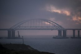 The Kerch bridge span opens for the passage of ships entrance, near in Kerch, Crimea, Monday, Nov. 26, 2018. The Ukrainian parliament is set to consider a presidential request for the introduction of martial law in Ukraine following an incident in which Russian coast guard ships fired on Ukrainian navy vessels. (AP Photo)