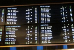 This Oct 25, 2018 photo shows the odds board at the sports book at the Tropicana casino in Atlantic City N.J. Gamblers bet $260 million on sports in New Jersey in October, bringing the total to nearly $600 million since mid-June. (AP Photo/Wayne Parry)