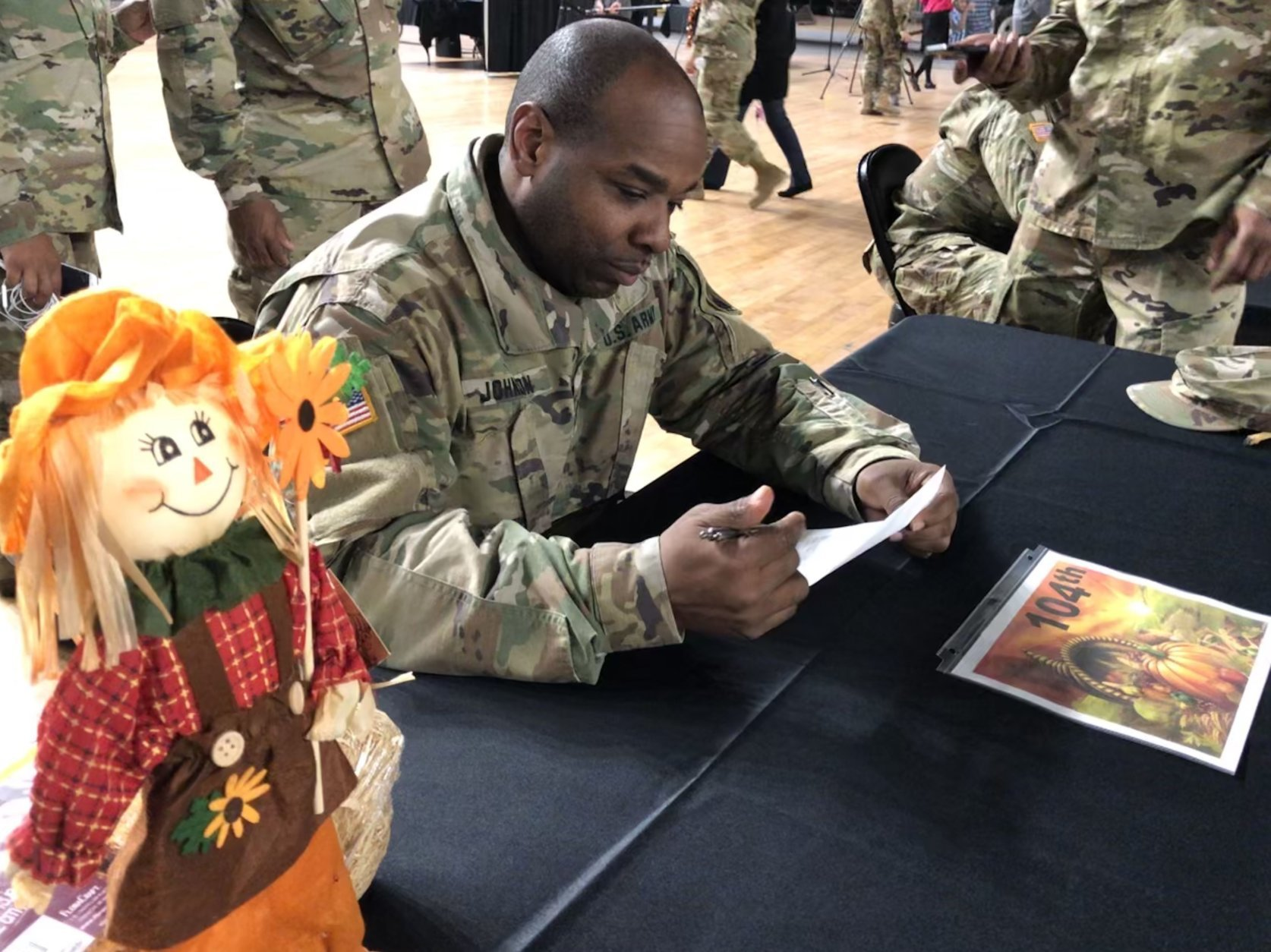 "Sgt. 1st Class Earl Johnson of the 104th Maintenance Company said of seeing people give back to military members who serve the community: ""It's uplifting, and it's another reason for me to give thanks during the holidays."" (WTOP/Kristi King)"