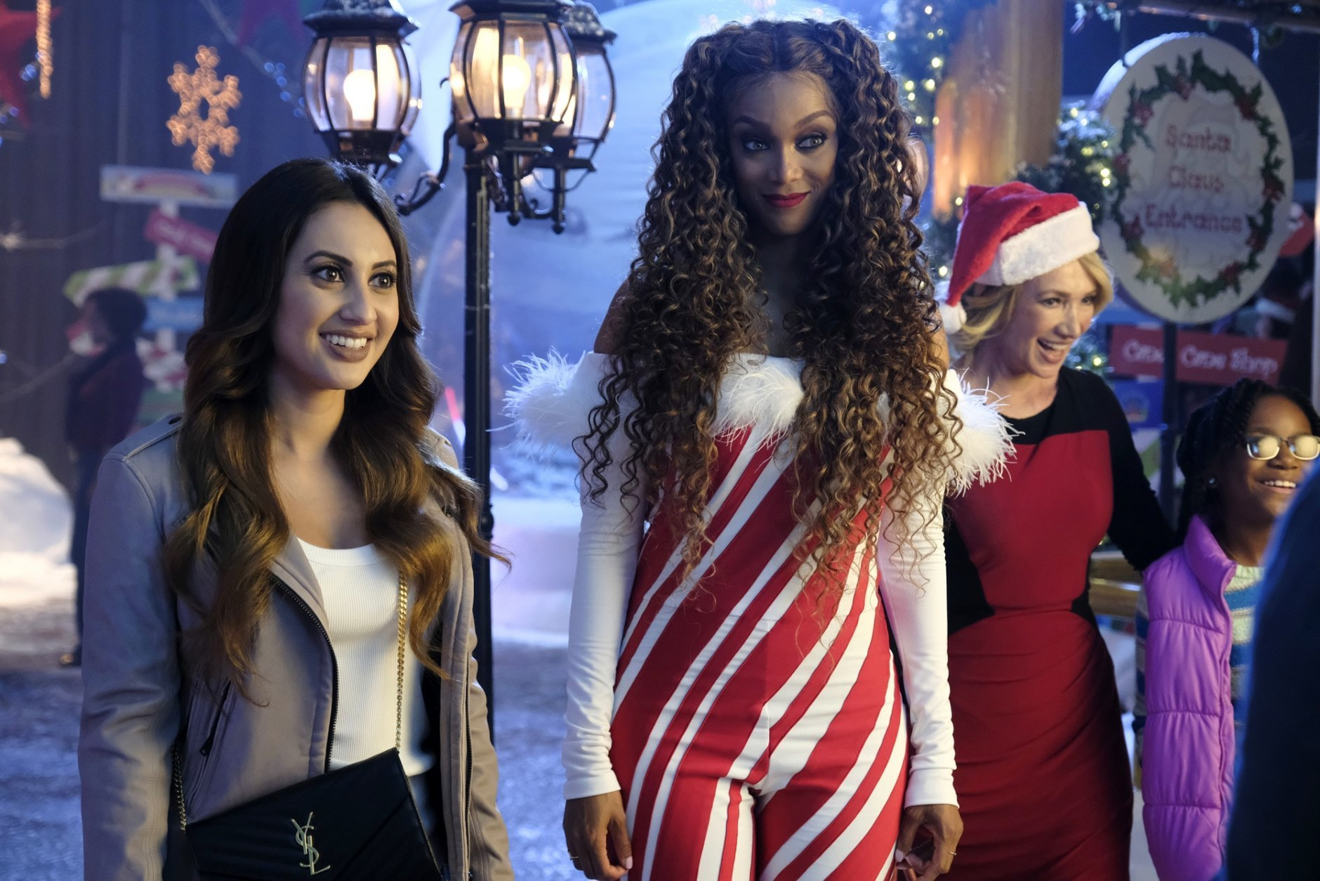 """This image released by Freeform shows Francia Raisa, left, and Tyra Banks in a scene from """"Life-Siz 2: A Christmas Eve,"""" airing on Sunday, Dec. 2, at 9:00 - 11:00 p.m. EST/PST on Freeform. (Disney Channel/Guy D'Alema)"""
