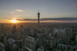 """This Friday, April 6, 2018 aerial photo shows Johannesburg's downtown. Millions of migrants jostle for work in the thriving underground economy of Gauteng province, whose name roughly translates to """"land of gold."""" Thousands of them die without identities or simply disappear during the journey. (AP Photo/Bram Janssen)"""