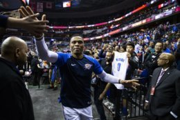 Oklahoma City Thunder guard Russell Westbrook high-fives fans as he exists the court following an NBA basketball game, Friday, Nov. 2, 2018, in Washington. The Thunder defeated the Washington Wizards 134-111. (AP Photo/Al Drago)