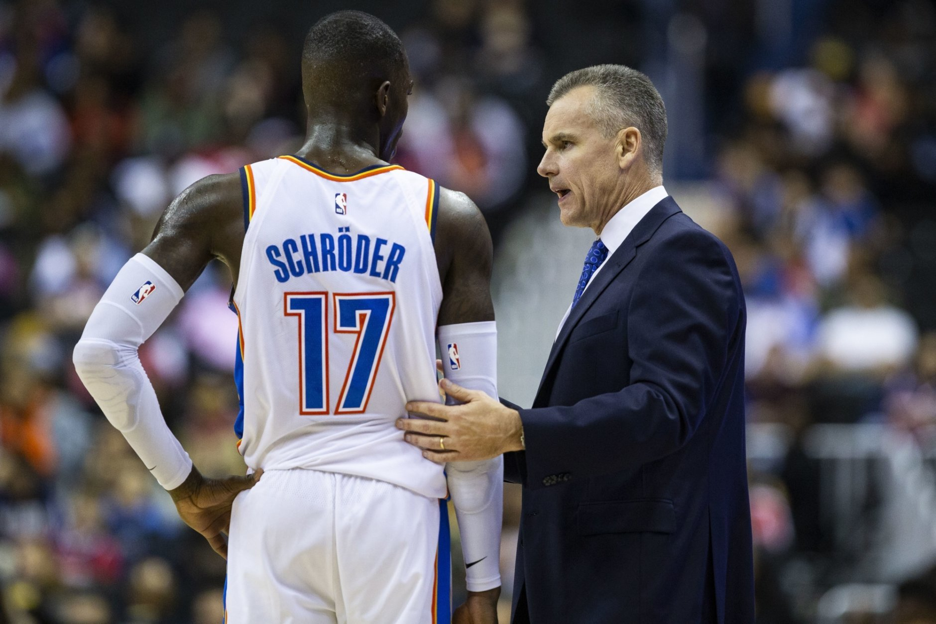 Oklahoma City Thunder coach Billy Donovan speaks with guard Dennis Schroeder during the second half the team's NBA basketball game against the Washington Wizards on Friday, Nov. 2, 2018, in Washington. The Thunder won 134-111. (AP Photo/Al Drago)