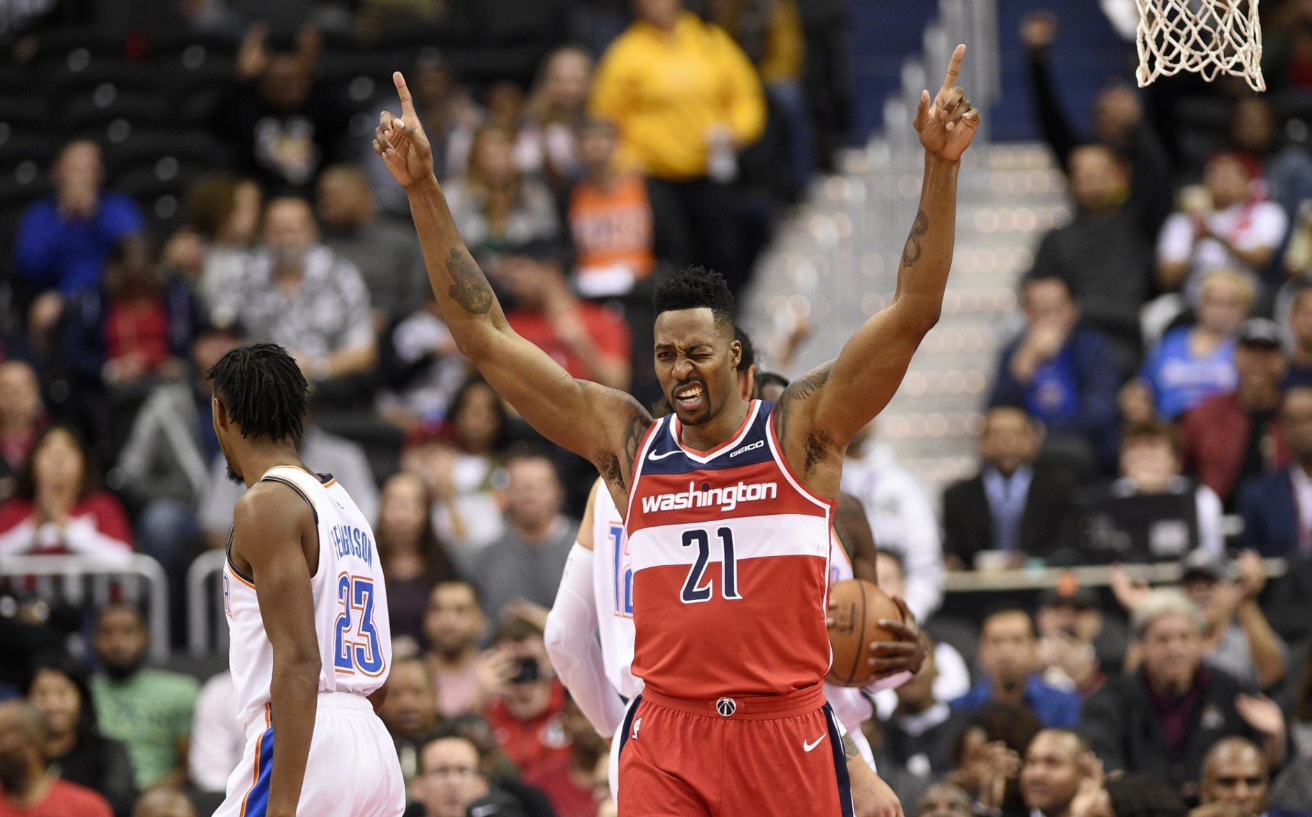 Washington Wizards center Dwight Howard (21) gestures after he dunked and was fouled during the first half of an NBA basketball game, as Oklahoma City Thunder guard Terrance Ferguson stands at left, Friday, Nov. 2, 2018, in Washington. (AP Photo/Nick Wass)