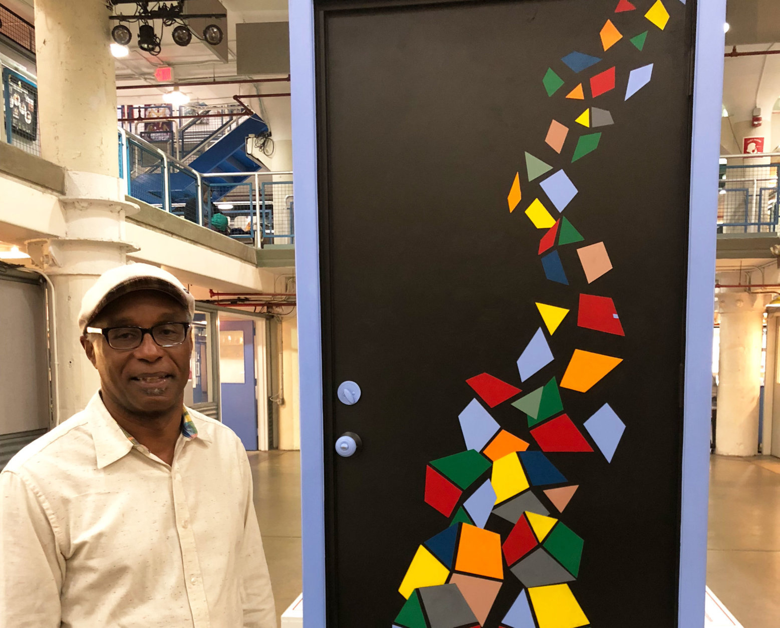 "Tim Davis is an Arlington, Virginia-based artist. He is also part of ""The Doors of Make Room"" project. (WTOP/Rachel Nania)"