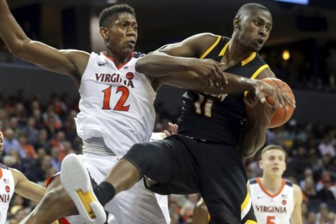 Jerome's 20 points lead No. 5 Virginia past Towson, 73-42