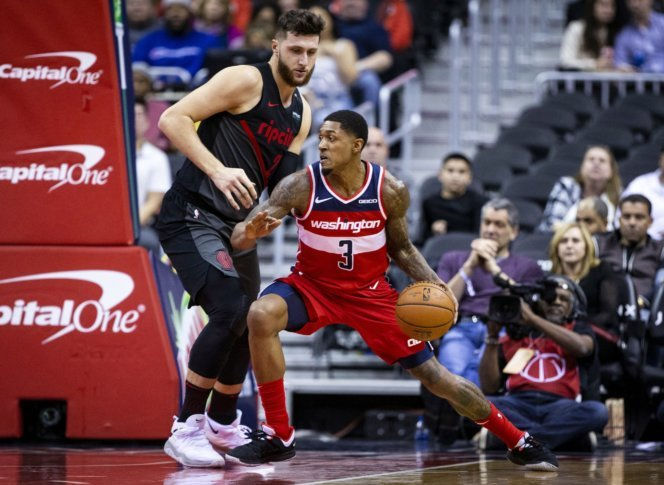Washington Wizards guard Bradley Beal (3) dribbles past Portland Trail  Blazers guard Wade Baldwin IV (2) during the first half of an NBA  basketball game ...