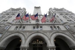 FILE - This Dec. 21, 2016 file photo shows the Trump International Hotel at 1100 Pennsylvania Avenue NW, in Washington. U.S. District Court Judge Richard Leon in Washington ruled Monday, Nov. 26, 2018, that the Cork Wine Bar may indeed be losing customers as lobbyists, political fundraisers and others flock to the nearby Trump International Hotel, but that does not constitute unfair competition under the local law. He wrote that to decide otherwise would mean other celebrities could not promote companies they own either. (AP Photo/Alex Brandon, File)