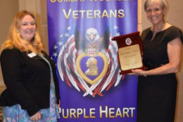 April Weiner of the National Court Reporters Association and Foundation and Nancy Hopp, former Foundation Chair accepted a plaque on behalf of NCRF from the Military Order of the Purple Heart. (Courtesy NCRA)