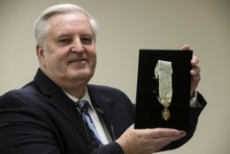 """Displayed is Alexander Hamilton's Society of the Cincinnati Eagle insignia by Douglas Hamilton, his fifth great-grandson, at the Museum of the American Revolution in Philadelphia, Monday, Nov. 12, 2018. This and other items loaned by Douglas Hamilton will be featured as part of the museum's """"Year of Hamilton."""" (AP Photo/Matt Rourke)"""
