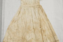 """Shown is a a baby dress with an accompanying note saying that it was made by Alexander Hamilton's window Elizabeth Hamilton, at the Museum of the American Revolution in Philadelphia, Monday, Nov. 12, 2018. This and other items loaned by the fifth great-grandson of Hamilton will be featured as part of the museum's """"Year of Hamilton."""" (AP Photo/Matt Rourke)"""