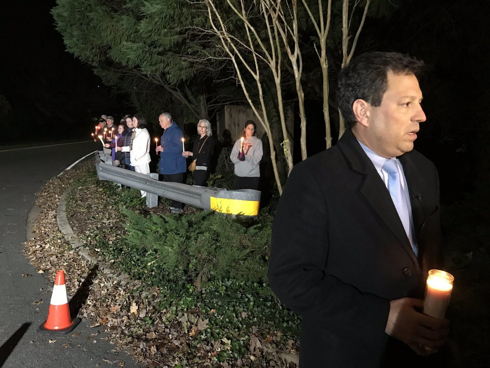 "Virginia state Sen. Scott Surovell organized the vigil. He lives about two blocks away from the shooting scene. He called the lack of answers about what happened nearly a year ago ""disturbing."" (WTOP/Michelle Basch)"