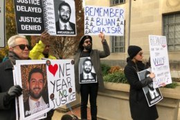 One year after Bijan Ghaisar died, family members gathered outside the U.S. Justice Department, seeking accountability. (WTOP/Neal Augenstein)
