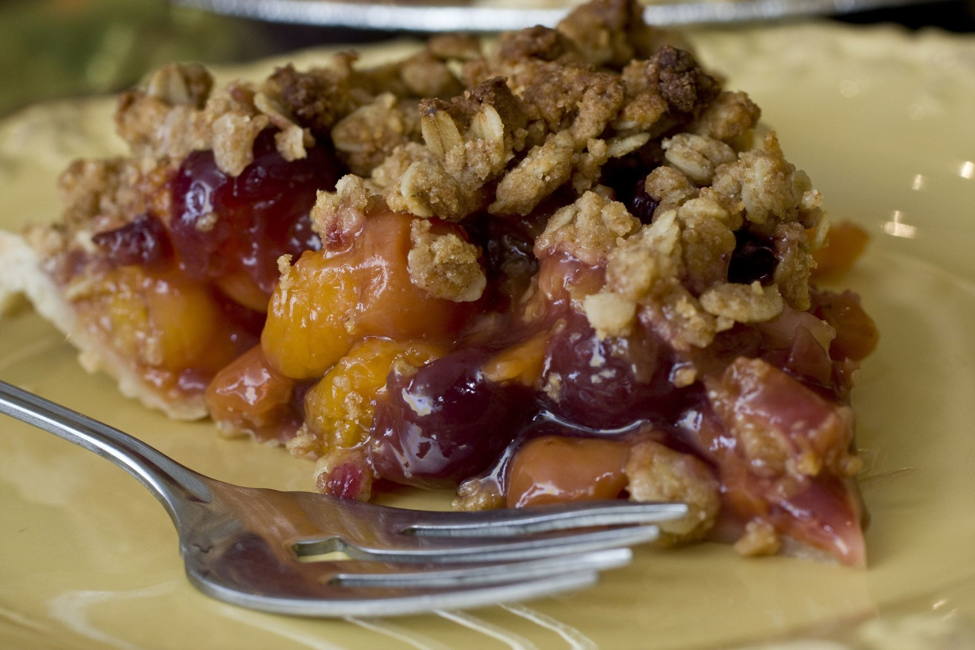 This photo taken Nov. 8, 2009 shows cherry-apricot crumb pie. A slice of pie on Thanksgiving is as traditional as a serving of turkey. You can make this tradition healthier by making good choices when choosing the crust. This cherry-apricot crumb pie is topped with a low-fat oat crumble made with whole-wheat flour that helps reduce any dietary regret. (AP Photo/Larry Crowe)