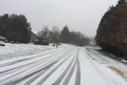 At least one neighborhood in Burke hasn't been plowed at all. (WTOP/John Domen)