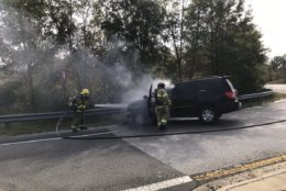 A Maryland State Police trooper got a driver out of an SUV shortly before it erupted into flames Wednesday afternoon. Prince George's County Fire/EMS extinguished the blaze. (Photo courtesy Prince George's County Fire/EMS Department)