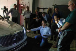 IIHS Board of Directors members preview an adaptive-driving-beam headlight system from Mercedes-Maybach. (Courtesy IIHS)